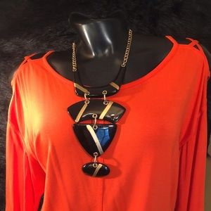 Chico's Orange top; openings on shoulder; size 2